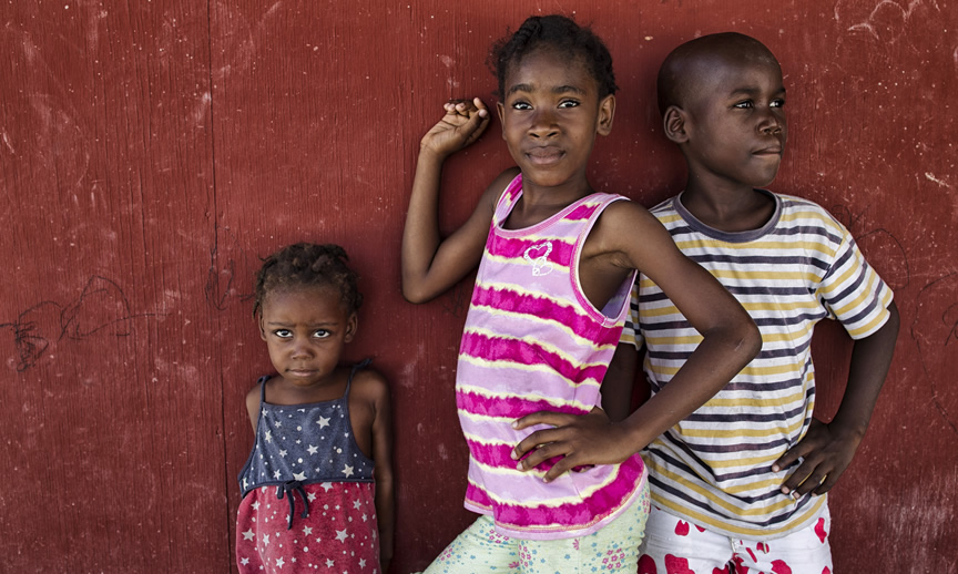 Children pose in a camp for internally displaced people in Haiti. UN Photo/Logan Abassi